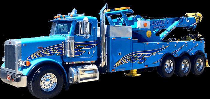 Blue tripple axle Alvey's Towing Truck